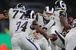 LONDON, ENGLAND - OCTOBER 22: Los Angeles Rams quarterback Jared Goff (16) hands off to Los Angeles Rams running back Malcolm Brown (34) during the NFL match between the Arizona Cardinals and the Los Angeles Rams at Twickenham Stadium on October 22, 2017 in London, United Kingdom. (Photo by Mitchell Gunn/ESPA-Images) *** Local Caption *** Jared Goff;Malcolm Brown