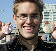 New Zealand's Moss Burmester with his gold and Bronze medals at the XVIII Commonwealth Games, Melbourne, Australia, Wednesday, March 22 2006. Photo: Michael Bradley/PHOTOSPORT
