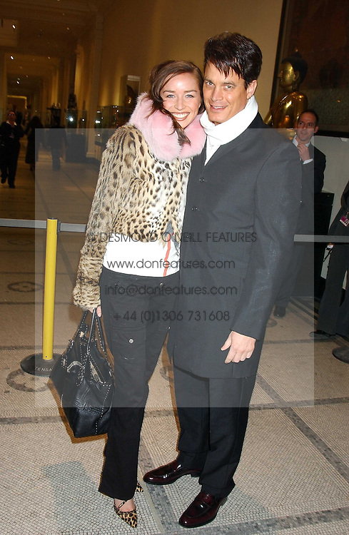 MATTHEW MELLON and NOELLE RENO at a fashion show and after party to celebrate the 20th Anniversay of fashion designer Ozwald Boateng held at the Victoria &amp; Albert Museum, London on 25th November 2005.<br />