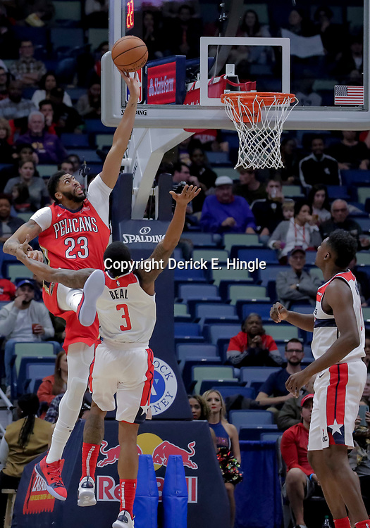 Nov 28, 2018; New Orleans, LA, USA; New Orleans Pelicans forward Anthony Davis (23) shoots over Washington Wizards guard Bradley Beal (3) during the first quarter at the Smoothie King Center. Mandatory Credit: Derick E. Hingle-USA TODAY Sports