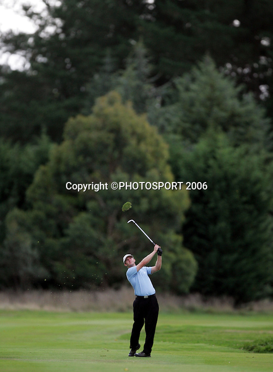 Shandon's Andrew Green plays an approach shot from the fairway during his match against Australia's Mitchell Brown in the 2006 New Zealand Mens Golf Amateur Championship final at Coringa Golf Course, Christchurch, on Sunday 9 April 2006. Photo: Tim Hales/PHOTOSPORT