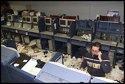 .TTP11/AP/28/4/LIFFE CLOSES /DIG .PIC BY ANDREW PARSONS LIFFE, LONDON. THE DISMANTLE OF THE BEAR PIT AS IT CLOSED TODAY ..DAN DOOLEY FROM LIFFE THE LAST TO LEAVE Bankers from Liffe surrounded by papers carrying on working as the bear pit is dismantled as Liffe closes in the City of London, April 2000. Photo By Andrew Parsons/i-ImagesCity traders and Bankers from Liffe surrounded by papers carrying on working as the bear pit is dismantled as Liffe closes in the City of London, April 2000. Photo By Andrew Parsons/i-Images