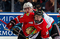 KELOWNA, CANADA - MARCH 3:  Nolan Foote #29 of the Kelowna Rockets back checks Jake Gricius #14 of the Portland Winterhawks on March 3, 2019 at Prospera Place in Kelowna, British Columbia, Canada.  (Photo by Marissa Baecker/Shoot the Breeze)
