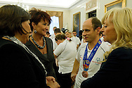 (L) ANNA KOMOROWSKA AND (C) JOLANTA KWASNIEWSKA AND (R) KATARZYNA FRANK NIEMCZYCKA WHILE SPECIAL OLYMPICS OFFICIAL VISIT AT PRESIDENTIAL PALACE IN WARSAW...THE IDEA OF SPECIAL OLYMPICS IS THAT, WITH APPROPRIATE MOTIVATION AND GUIDANCE, EACH PERSON WITH INTELLECTUAL DISABILITIES CAN TRAIN, ENJOY AND BENEFIT FROM PARTICIPATION IN INDIVIDUAL AND TEAM COMPETITIONS..WARSAW , POLAND , OCTOBER 19, 2011..MANDATORY CREDIT: PHOTO BY ADAM NURKIEWICZ / MEDIASPORT