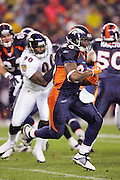 DENVER - OCTOBER 9:  Running back Tatum Bell #26 of the Denver Broncos runs the ball against the Baltimore Ravens at INVESCO Field at Mile High on October 9, 2006 in Denver, Colorado. The Broncos defeated the Ravens 13-3. ©Paul Anthony Spinelli *** Local Caption *** Tatum Bell