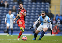 Swansea City's Jordi Amat competes with Blackburn Rovers's David Dunn - Photo mandatory by-line: Richard Martin Roberts/JMP - Mobile: 07966 386802 - 24/01/2015 - SPORT - Football - Blackburn - Ewood Park - Blackburn Rovers v Swansea City - FA Cup Fourth Round