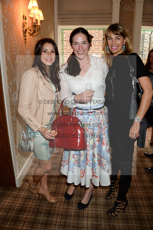 Left to right, LAUREN KEMP, CLAIRE JAMES and ASSIA WEBSTER at the Blue Monday Cheese Launch presented by Alex James and held at The Cadogan Hotel, Sloane street, London on 11th June 2013.