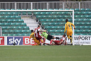 Ashley Vincent of Cheltenham Town scores his side's first goal. Skybet football league 2 match, Newport county v Cheltenham Town at Rodney Parade in Newport, South Wales on Saturday 22nd Feb 2014.<br /> pic by Mark Hawkins, Andrew Orchard sports photography.