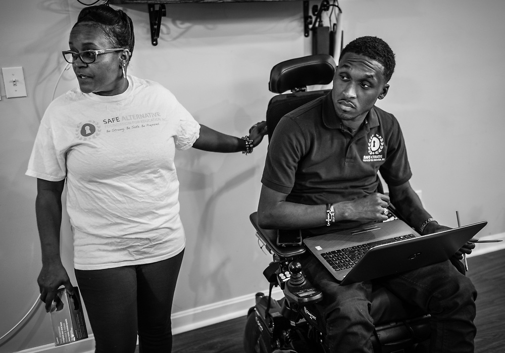 BALTIMORE, MD -- 2/8/16 -- Safe Alternatives is more than just an effort by Van. His family is a big part of the project. His mother, Shelly Jones-Brooks, stands by at left. <br /> Van Brooks at Safe Alternatives. Brooks was paralyzed at age 16 after a football accident. He has recovered more function than doctors ever hoped he would and subsequently opened a youth center in West Baltimore.&hellip;by Andr&eacute; Chung #_AC11350