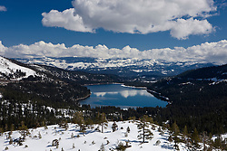 Aerial view of Donner Lake with snow in the mountains along Donner Pass, California, United States of America