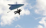 Hang glider pilot Thomas Atkins and a passenger fly above Randall Airport in Middletown on Friday, Aug. 23, 2013. The hang glider rides are offered by Hangar 3.