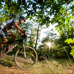 As the sun sets the forest comes aglow during the 24 Hours in the Enchanted Forest on Saturday evening. The first annual event drew about 240 racers, but event organizers expect that figure to double next year due to the event's success..