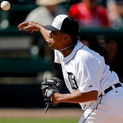 Feb 27, 2013; Lakeland, FL, USA; Detroit Tigers relief pitcher Octavio Dotel (20) throws against the Atlanta Braves during the top of the fifth inning of a spring training game at Joker Marchant Stadium. Mandatory Credit: Derick E. Hingle-USA TODAY Sports