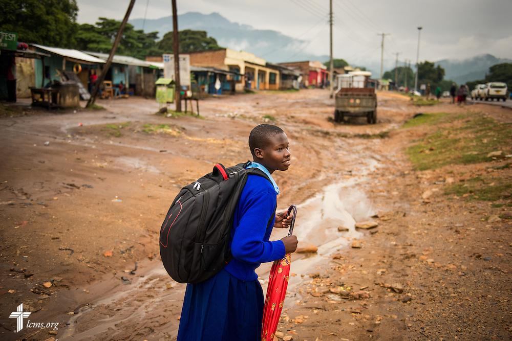 Pamela Cherotich from the U-Dom ELCK (Evangelical Lutheran Church in Kenya) Project 24 site walks through Chepareria, Kenya on Friday, June 24, 2016.  LCMS Communications/Erik M. Lunsford