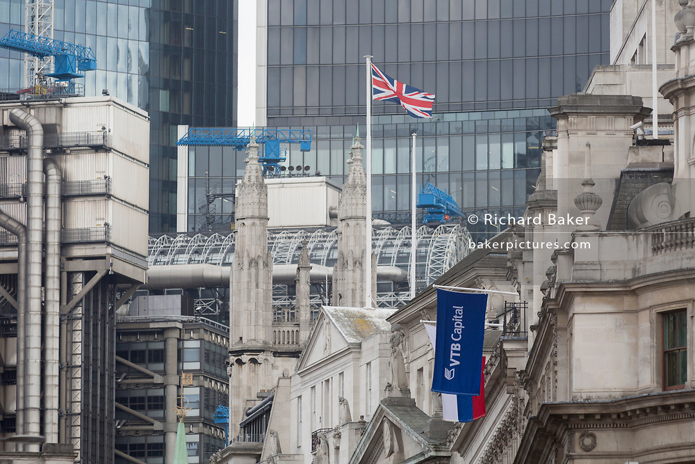 The flags of the Russian Federation and Russian investment Bank VTB Capital hang over banks and other financial institutions in the City of London, the capital's financial district (aka The Square Mile), on 26th March, 2018, in London, England.  VTB Capital operates in London, Singapore, Hong Kong, Sofia, New York, Zug and Frankfurt, with headquarters in Moscow.