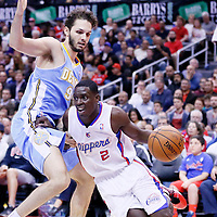 15 April 2014: Los Angeles Clippers guard Darren Collison (2) drives past Denver Nuggets guard Evan Fournier (94) during the Los Angeles Clippers 117-105 victory over the Denver Nuggets at the Staples Center, Los Angeles, California, USA.