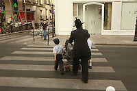 takiing kids to school in Paris.April 24 2006..photograph by Owen Franken........ - Photograph by Owen Franken