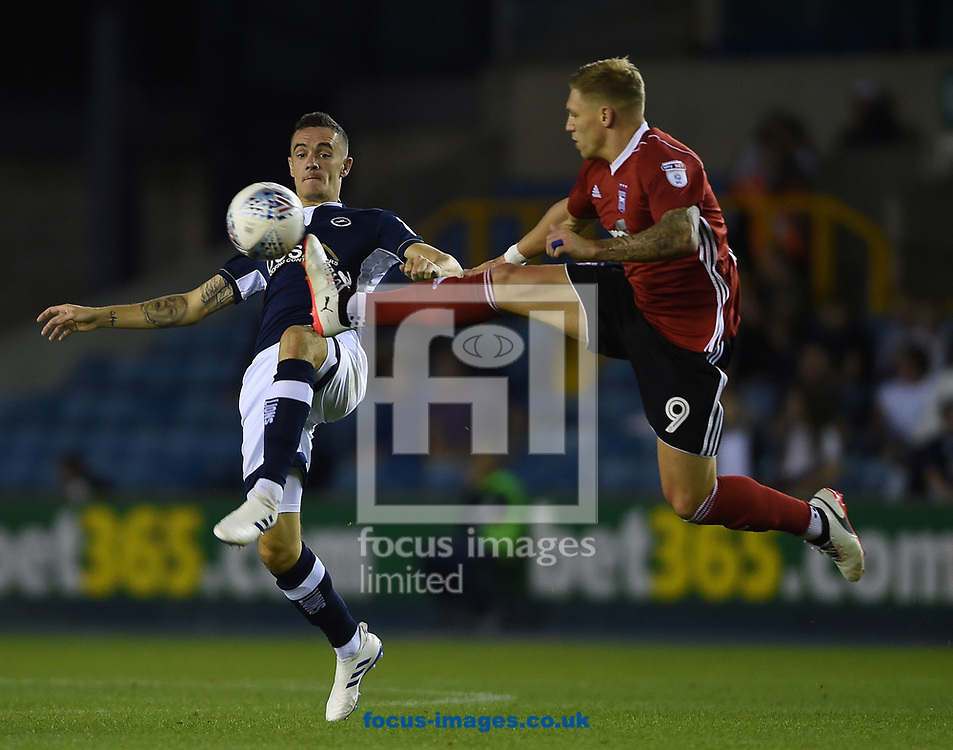 Ipswich Town&rsquo;s Martyn Waghorn and Millwall&rsquo;s Shaun Williams battle for the ball during the Sky Bet Championship match at The Den, London<br /> Picture by Daniel Hambury/Focus Images Ltd 07813022858<br /> 15/08/2017