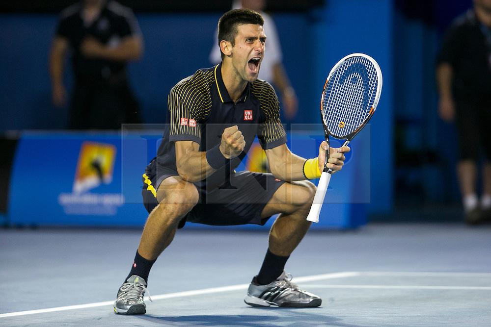 © Licensed to London News Pictures. 27/01/2013. Melbourne Park, Australia. Novak Djokovic celebrates after winning the Australian Open during the Mens Final between Novak Djokovic and Andy Murray of the Australian Open. Photo credit : Asanka Brendon Ratnayake/LNP