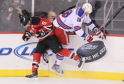 Mar 6; Newark, NJ, USA; New Jersey Devils left wing Zach Parise (9) hits New York Rangers defenseman Marc Staal (18) during the third period at the Prudential Center. The Devils defeated the Rangers 4-1.