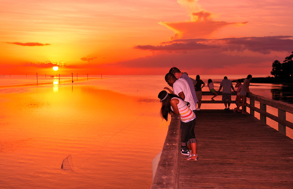 People on Fishing Pier at Bayport Park at Sunset, Pine Island, near Spring Hill, Florida, USA