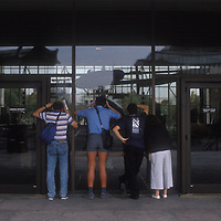 Visitors peer through the windows of the Air and Space Museum in Washington, DC in October 1990 when the museum was closed due to a  government shutdown.