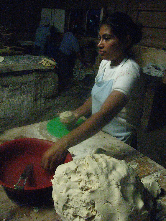 A woman rolls the masa for tortillas at a coffee farm in the north of Nicaragua near Matagalpa.