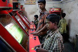 BANGLADESH DHAKA KAWRAN BAZAAR 27FEB05 - Delinquent child gaming on a console at Kawran Bazaar vegetable market. The Bazaar has been in the Tejgaon area for at least 30 years and is one of the largest markets in Dhaka city...jre/Photo by Jiri Rezac ..© Jiri Rezac 2005..Contact: +44 (0) 7050 110 417.Mobile:  +44 (0) 7801 337 683.Office:  +44 (0) 20 8968 9635..Email:   jiri@jirirezac.com.Web:    www.jirirezac.com..© All images Jiri Rezac 2005- All rights reserved.