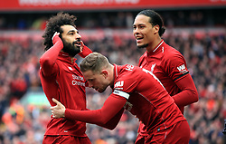 File photo dated 14-04-2019 of Liverpool's Mohamed Salah (left) celebrates scoring his side's second goal of the game against Chelsea with team-mates during the Premier League match at Anfield, Liverpool.