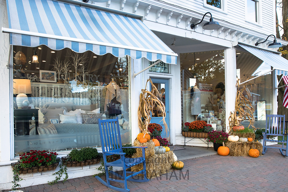 The Country Store with rocking chairs and pumpkins on Main Street in Stowe, Vermont, USA