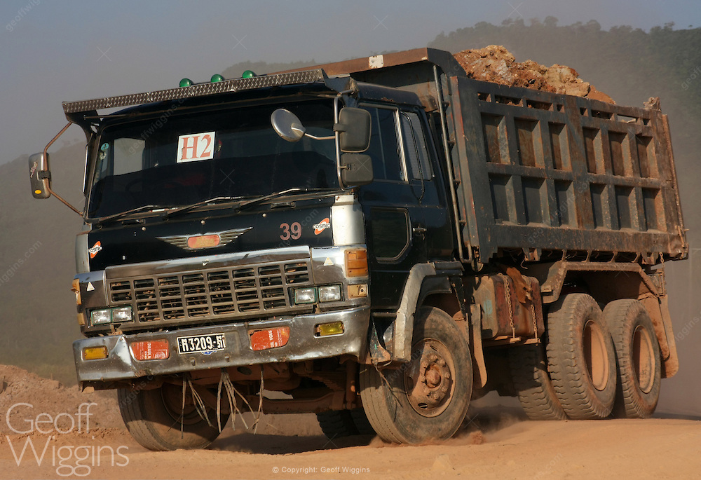 Cambodian Hino FS 27 dump truck transporting rock during road construction work near Kampot in southern Cambodia
