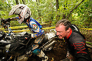 Bill Dragoo of Oklahoma strains to push R1200GS over obstacle while Briene Thompson from San Diego guides the bike and applies throttle.