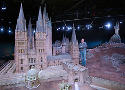 Model maker Jose Granell  with a model of Hogwarts Castle  which was revealed for the first time , Thursday, March 1st , as part of the Warner Bros Studio tour - The Making of Harry Potter in Leavesden, Hertfordshire.  Photo by: Andrew Parsons  / i-Images