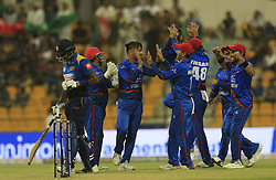 September 17, 2018 - Abu Dhabi, United Arab Emirates - Afghanistan cricketers celebrate after taking a wicket during the 3rd cricket match of Asia Cup 2018 between Sri Lanka and Afghanistan at the Sheikh Zayed Stadium,Abu Dhabi, United Arab Emirates. 09-17-2018  (Credit Image: © Tharaka Basnayaka/NurPhoto/ZUMA Press)