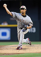 PHOENIX, AZ - MAY 27:  Pitcher Yu Darvish #11 of the Texas Rangers against the Arizona Diamondbacks in the second inning of an interleague game at Chase Field on May 27, 2013 in Phoenix, Arizona.  (Photo by Jennifer Stewart/Getty Images) *** Local Caption *** Yu Darvish