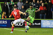 Forest Green Rovers Udoka Godwin-Malife(22) takes on Swindon Town's Jerry Yates(9) during the EFL Sky Bet League 2 match between Forest Green Rovers and Swindon Town at the New Lawn, Forest Green, United Kingdom on 21 December 2019.