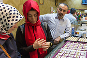 Muslim woman with  gold ring in jewelry shop in The Grand Bazaar, Kapalicarsi, great market, Beyazi, Istanbul, Turkey