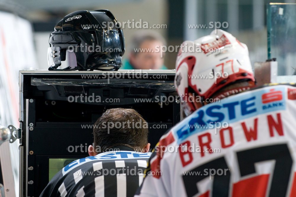 Referee Thomas Berneker watches video judge during ice-hockey match between HDD Tilia Olimpija and EC KAC in 32nd Round of EBEL league, on December 30, 2010 at Hala Tivoli, Ljubljana, Slovenia. (Photo By Matic Klansek Velej / Sportida.com)
