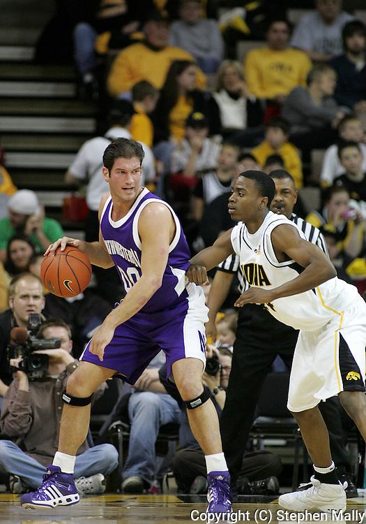 15 FEBRUARY 2007: Northwestern guard/foward Tim Doyle (00) is guarded by Iowa guard Justin Johnson (24) in Iowa's 66-58 win over Northwestern at Carver-Hawkeye Arena in Iowa City, Iowa on February 15, 2007.
