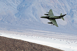 A Draken operated Douglas A-4K Skyhawk, flies low level through the Jedi Transition, Star Wars Canyon, Death Valley National Park, California, United States of America