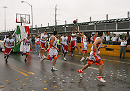 "Photo by Alex Jones..The Rio Grande Valley Silverados and the Reynosa Correcaminos play an exhibition basketball game in the middle of the Hidalgo - Reynosa International Bridge on Tuesday morning.  The game shut down traffic into Mexico for 15 minutes, and prompted McAllen Mayor Richard Cortez to wonder out loud, ""Where else can you possibly do this other than the border?"""