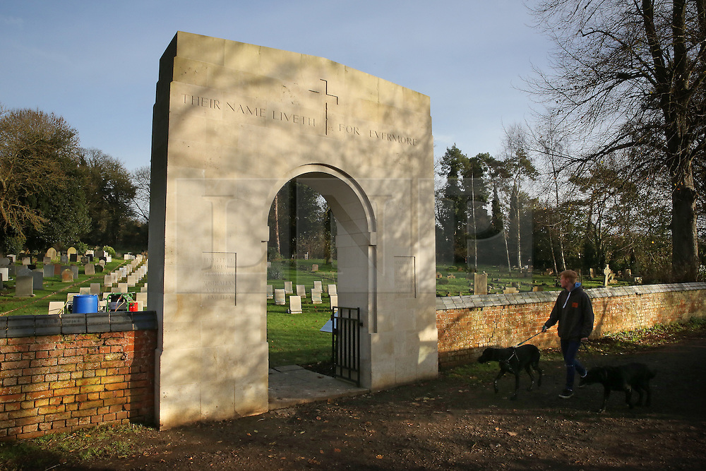 © Licensed to London News Pictures. 23/11/2015. London, UK. The Australian Military Cemetery next to St Mary's Parish Church in Harefield. Vandals have spray painted some of the grave stones and have taken a saw to the flagpole. Photo credit: Peter Macdiarmid/LNP