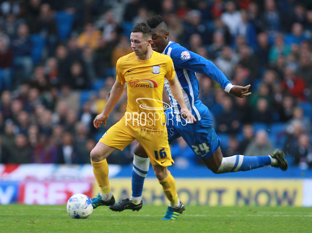 Preston North End midfielder Alan Browne gets the better of Brighton central midfielder Rohan Ince during the Sky Bet Championship match between Brighton and Hove Albion and Preston North End at the American Express Community Stadium, Brighton and Hove, England on 24 October 2015. Photo by Bennett Dean.