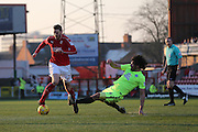 Swindon Town Ben Gladwin (7) runs through a tackle by Peterborough Micheal Bostwick (4) first half 0-0 during the EFL Sky Bet League 1 match between Swindon Town and Peterborough United at the County Ground, Swindon, England on 21 January 2017. Photo by Gary Learmonth.