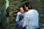 Israel, Yardenit Baptismal Site In the Jordan River Near the Sea of Galilee, pilgrims being Baptized