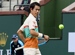 March 10, 2019 - Indian Wells, CA, U.S. - INDIAN WELLS, CA - MARCH 10: Kei Nishikori (JPN) watches a ball hit by Adrian Mannarino (FRA) go out of bounds in the first set of a match played at the BNP Paribas Open on March 10, 2019 at the Indian Wells Tennis Garden in Indian Wells, CA. (Photo by John Cordes/Icon Sportswire) (Credit Image: © John Cordes/Icon SMI via ZUMA Press)