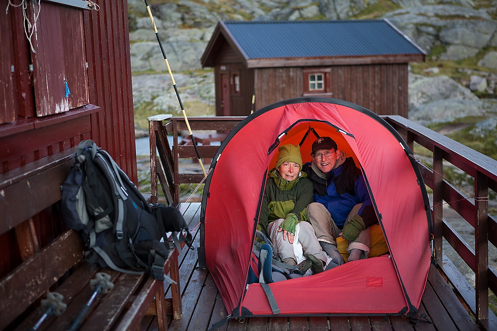 Liana (left) and Parmenter Welty camp on the front porch of the Norwegian Trekking Association's Munkebu Hut (closed at the time) on Moskenesoya, Lofoten Islands, Norway.