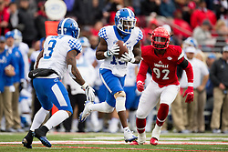 Kentucky wide receiver Jeff Badet, center takes a reverse from running back Jojo Kemp in the second half.. The University of Louisville hosted Kentucky, Saturday, Nov. 26, 2016 at Papa John's Cardinal Stadium in Louisville. Kentucky won the game 41-38.
