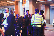 MANCHESTER 19.09.2017 A a group  of  people share a  joke with  police officers with one person  trying on a   police man hates as Freshers week continues in Manchester which has seen 1000s of students out drinking every night since Sunday.