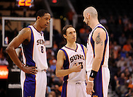 Mar. 14, 2012; Phoenix, AZ, USA; Phoenix Suns forward Channing Frye (8) , guard Steve Nash (13) and center Marcin Gortat (4) talk while on the court against the Utah Jazz during the first half at the US Airways Center. Mandatory Credit: Jennifer Stewart-US PRESSWIRE..